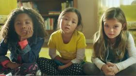 The three girls in the ad, bored silly by pretty pink princess TV advertising, take action.